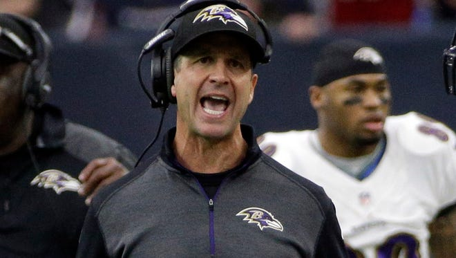 Baltimore Ravens head coach John Harbaugh works the sideline against the Houston Texans during the first half of an NFL football game Sunday, Dec. 21, 2014, in Houston.