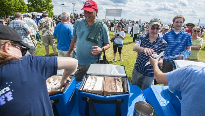 People line up for free Ben & Jerry's ice cream before Vermont Sen. Bernie Sanders announces he is a candidate for the Democratic nomination for president at Waterfront Park in Burlington on Tuesday, May 26, 2015.