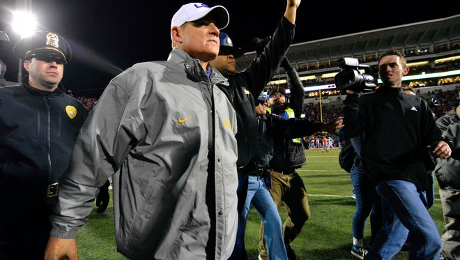 LSU head coach Les Miles walks on the field after the game Saturday against Ole Miss at Vaught-Hemingway Stadium.