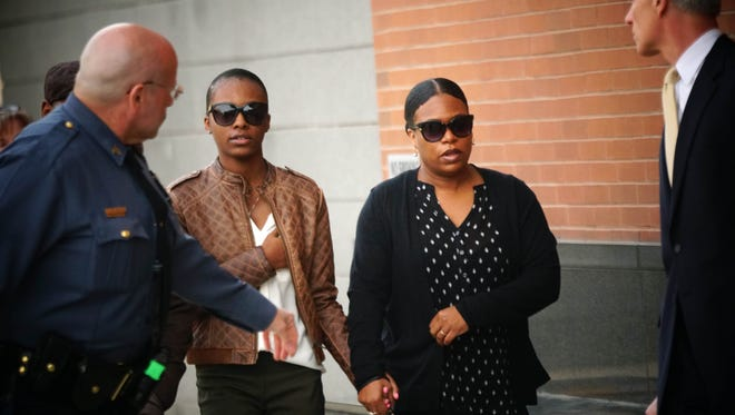 Surrounded by, family, her attorney and security, 17 year-old Trinity Carr, walks into the New Castle County Courthouse on Monday morning to face charges of criminally negligent homicide, a felony, and third-degree criminal conspiracy, a misdemeanor in the death of her Howard High School classmate 16-year-old Amy Inita Joyner-Francis.