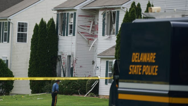 Police continue investigating the scene on the 500 block of St. Michaels Drive in the Brick Mill Farm development where  26 year-old Burgon Sealy Jr. was holed up in his family home and shot killed Thursday morning.