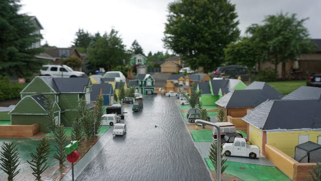 Fred Olheiser spared no detail in matching paint color and cloning roof peeks on the houses of his scale model of the cul-de-sac he lives on in southeast Salem.