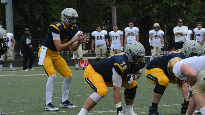 Quarterback Luke Johnston, who played at Southport High School, is coming off one of the most efficient seasons in Marian University history.