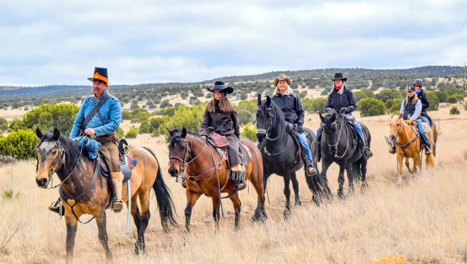 Dressing the part, a dragoon reenactor leads the first equestrian tour of historic Fort Stanton, one of the new adventures offered at the historic site north of Ruidoso in Lincoln County.