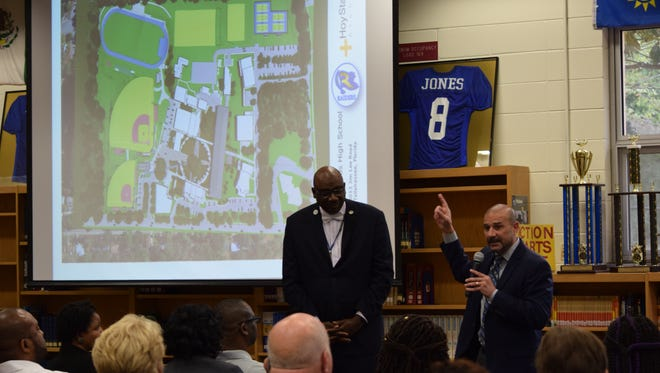 Rickards Principal Doug Cook (left) and Superintendent Rocky Hanna discuss upgrades for Rickards High School with community members Tuesday night.
