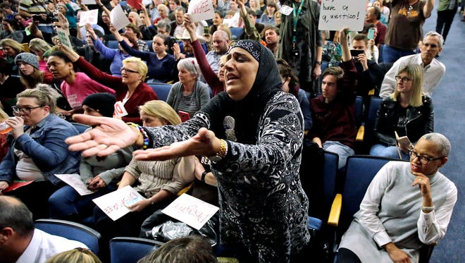 This Feb. 9, 2017, file photo, Noor Ul-Hasan reacts during Rep. Jason Chaffetz's town hall meeting at Brighton High School, in Cottonwood Heights, Utah. Utah refugee officials and Muslim advocates said Monday, March 6, that President Donald Trump's revised travel ban doesn't alleviate their concerns about an initiative they contend unfairly targets refugees and Muslim countries.