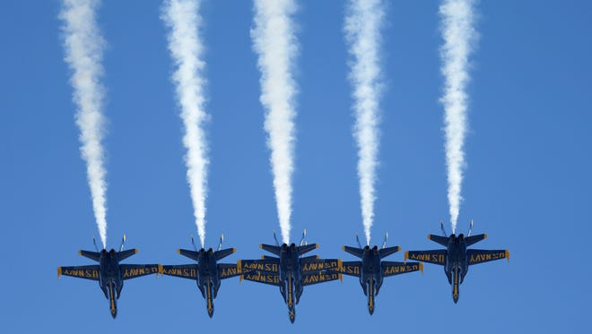 The Blue Angels fly over an NFL game in 2015.