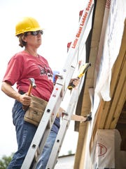 Becky Graves works on the new addition to Bethel Lutheran Church on Thursday. Graves, a member of Mission Builders, has worked on the addition since the beginning of May.