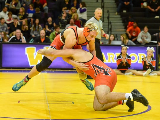 At 220lbs Valley's Rocky Lombardi sprawls as Ames' Harrison Townsend shoots in for a takedown on Thursday, December 10, 2015, during a wrestling meet held at Waukee High School.