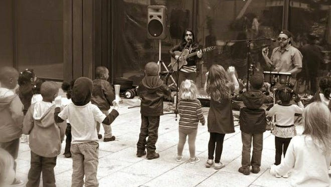 Chrisie Santoni and Craig Smith, of The Billies and Dancing Bear Music, entertain a crowd of little ones.