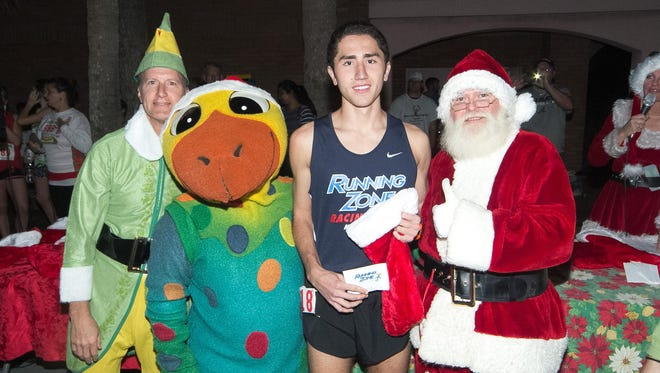 Santa Claus gives the thumbs up to 2014 Jingle Bell 2 Miler winner Andrew Cacciatore, who finished the race in an amazing 9 minutes, 42 seconds.