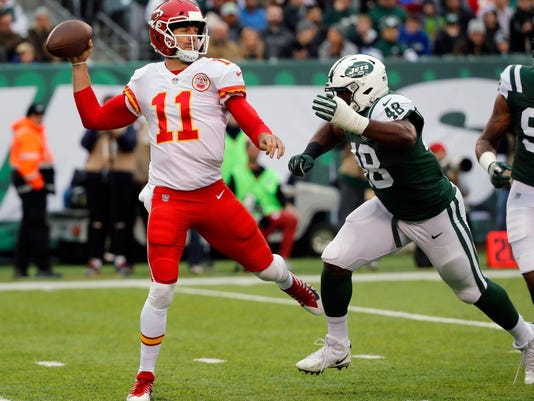 """FILE - In this Dec. 3, 2017, file photo, Kansas City Chiefs quarterback Alex Smith throws during the first half of an NFL football game against the New York Jets in East Rutherford, N.J. The Chiefs play the Oakland Raiders this week. """"This is it. We're in the fourth quarter of the season. Three out of the four are division games,"""" Chiefs quarterback Alex Smith said. """"We can't get ahead of ourselves. Right here, we have a team that beat us earlier this year and we have to find a way to rebound."""" (AP Photo/Julie Jacobson, File)"""