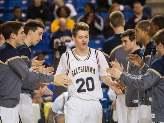 Salesianum's David Barone walks out during player introductions before the start of the Boys State Basketball Championship on Saturday afternoon, March 8, 2014.