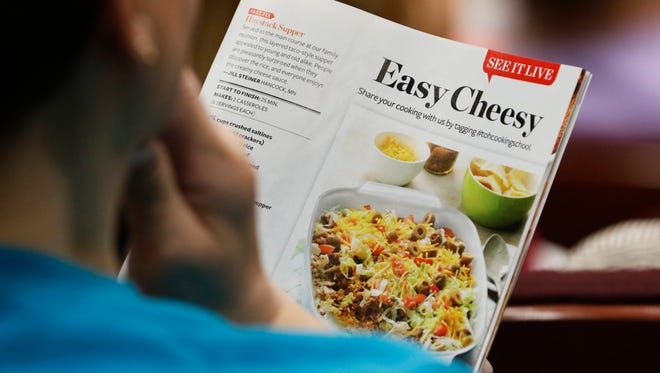 File - A person reads a recipe during the 32nd Taste of Home Cooking School May 12, 2016, at Silver Lake College in Manitowoc.