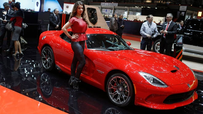 A model poses in front of the Dodge Viper GTS on the second press day of the Geneva International Motor Show on March 4, 2015 in Geneva, Switzerland.