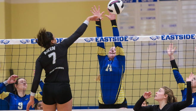 Eastside's Allie Wright goes up for the block at the net in the first game of a playoff match Thursday night at Eastside.