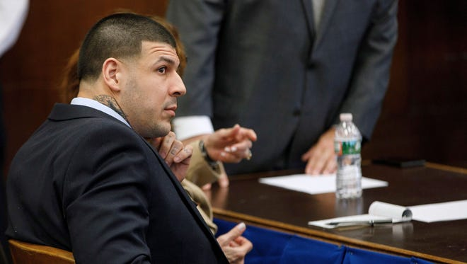 Former New England Patriots tight end Aaron Hernandez sits at the defense table during jury deliberations in his double murder trial of at Suffolk Superior Court in Boston,  Wednesday, April 12, 2017.