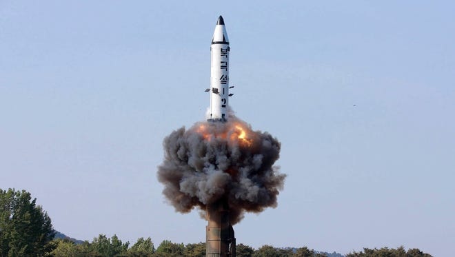 """In this undated file photo distributed by the North Korean government on May 22, 2017, a solid-fuel """"Pukguksong-2"""" missile lifts off during its launch test at an undisclosed location in North Korea. North Korea said Wednesday that it was examining operational plans for attacking Guam, an angry reaction to U.N. punishment for recent North Korean intercontinental ballistic missile tests and a U.S. suggestion about preparations for possible preventive attacks to stop the North's nuclear weapons program."""