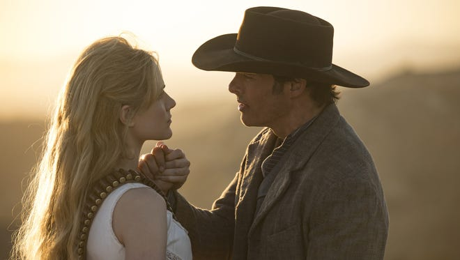 Evan Rachel Wood, left, who plays android host Dolores, and James Marsden, who plays host Teddy, maintain an emotional connection even without programmed narratives on HBO's 'Westworld.'