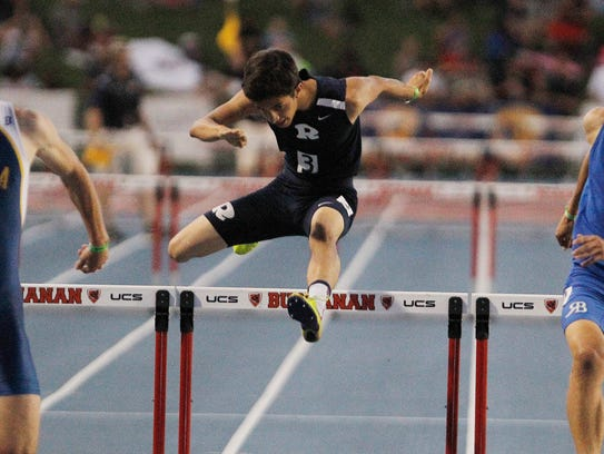 Brandon Andrade of Redwood hits the hurdle in the 300 meter hurdle event at the CIF Track and Field Championships at Buchanan High School Saturday, June 2, 2018 in Clovis, Calif.
