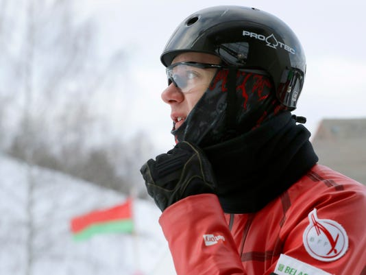 """In this Sunday, Feb. 4, 2018 photo, Belarusian freestyle skier Dmitry Mazurkevich trains at a national training base just north Minsk, Belarus. The lessons learned from the vaunted Soviet gymnastics program all those years ago are still producing Olympic gold medalists - in freestyle skiing.  Competitors from Belarus won the men's and women's aerials gold at the 2014 Sochi Olympics, and they will be in contention again this year in Pyeongchang. """"Apart from great technique,"""" said world junior champion Mazurkevich, who has been left out of the Pyeongchang team, """"we're taught to conquer ourselves, to conquer the fear that rises in me every time before the jump."""" (AP Photo/Sergei Grits)"""