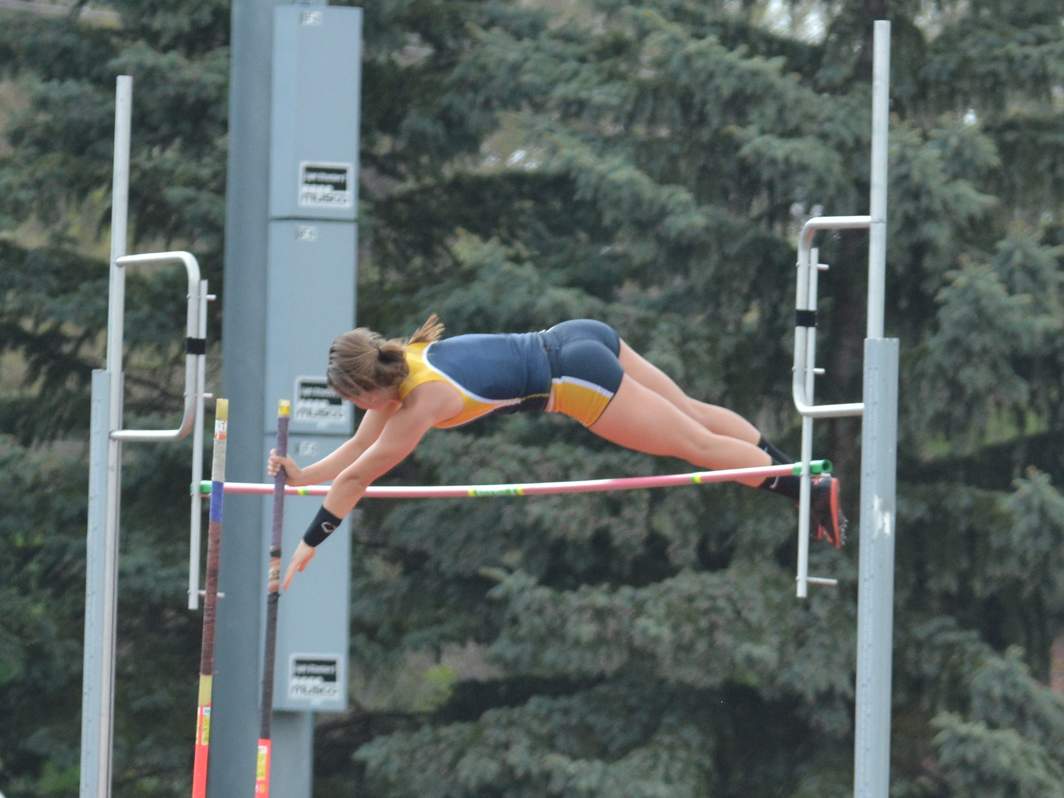 South Lyon's Emma Bauer clears the bar at the KLAA Kensington Conference meet.