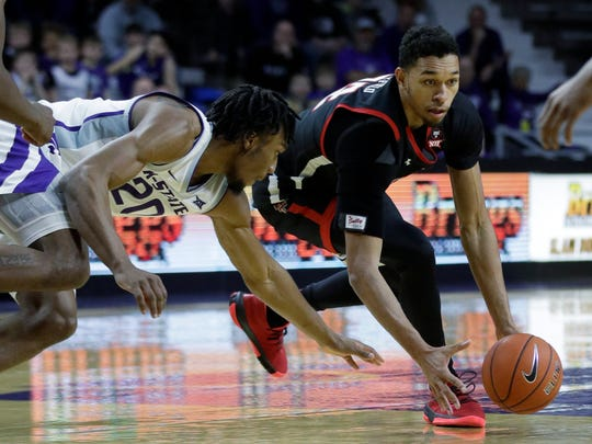 Texas Tech forward TJ Holyfield, right, beats Kansas State forward Xavier Sneed (20) to a loose ball during the first half of an NCAA college basketball game in Manhattan, Kan., Tuesday, Jan. 14, 2020. (AP Photo/Orlin Wagner)