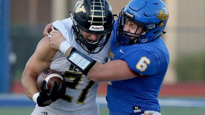 Hutchinson's Jack Hawver (6) tackles Newton's Kenyon Forest (21) during their game Friday night, Sept. 25, 2020. Hutchinson defeated Newton 54-42. Hawver earned all-state honors by the KFBCA.