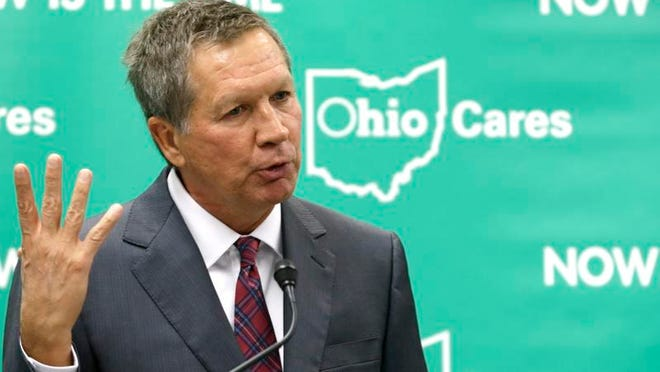 Ohio Gov. John Kasich speaks at the Cleveland Clinic in October, advocating for Medicaid expansion. Kasich used the seven-member Controlling Board to get approval to accept federal money to expand the state health care system in one of his signature moves of 2013.