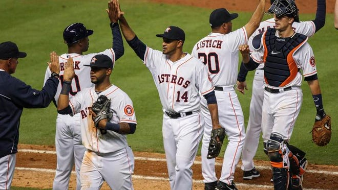 Houston Astros first baseman Jesus Guzman (14) celebrates with teammates after defeating the New York Yankees 6-2 at Minute Maid Park.