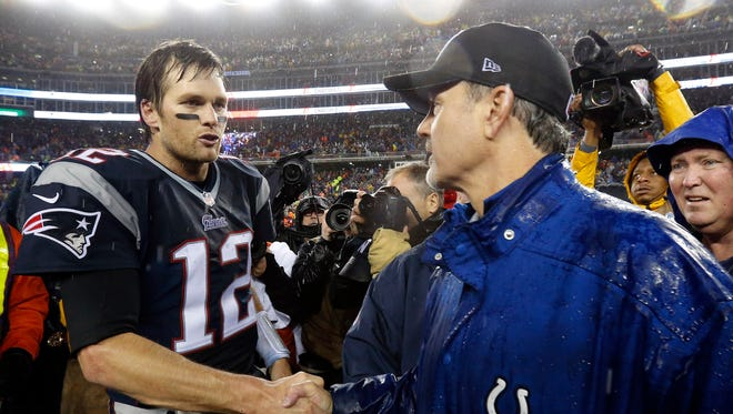 New England Patriots quarterback Tom Brady, left, shakes hands with Indianapolis Colts head coach Chuck Pagano after the NFL football AFC Championship game Sunday, Jan. 18, 2015, in Foxborough, Mass. The Patriots defeated the Colts 45-7 to advance to the Super Bowl against the Seattle Seahawks. (AP Photo/Julio Cortez)