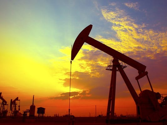 an-oil-pumping-unit-at-sunset_large.jpg