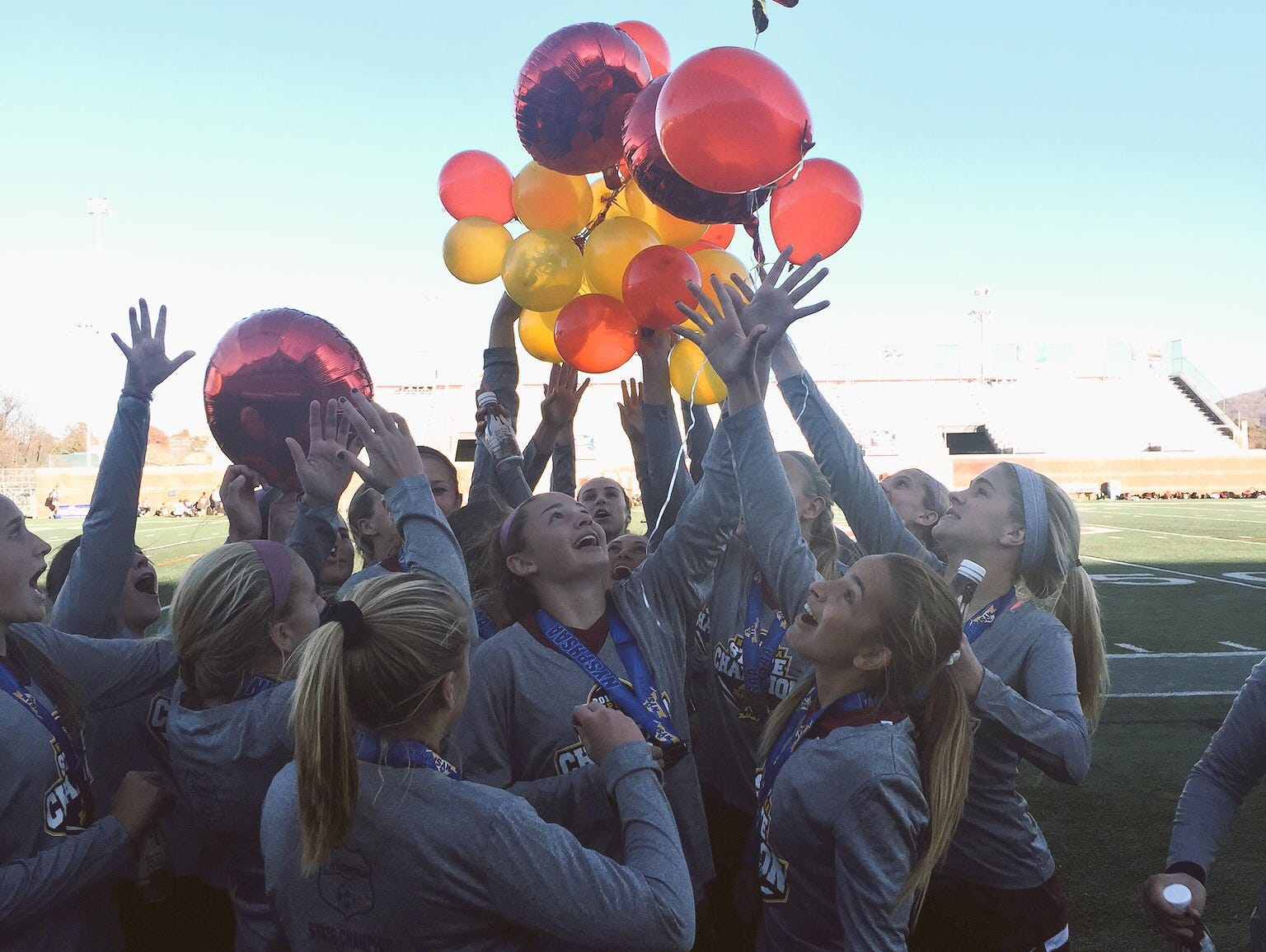 In celebration of its state title, Arlington released colorful balloons over the field.