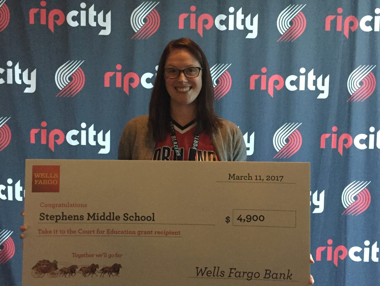 Aimee Leaton, volleyball coach and language arts teacher at Stephens Middle School, received a $4,900 grant from the Trail Blazers Foundation on Saturday prior to the Blazers game against Washington at Moda Center.
