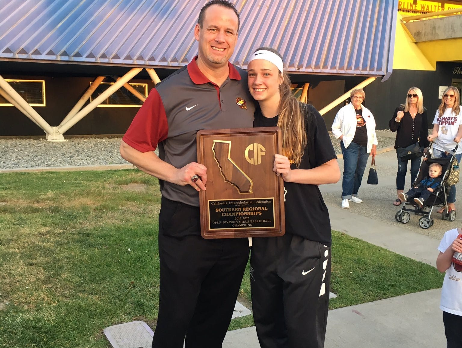 Former Reno coach Craig Campbell, now at Clovis West, is shown with his daughter Madison after winning the Southern California Regional last Saturday.