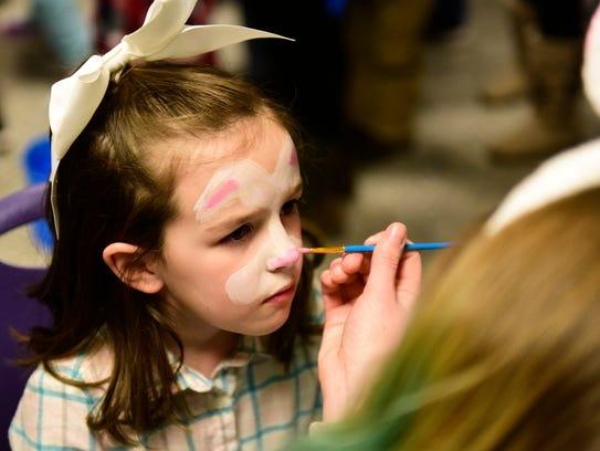 Lexi Martikan, 6, of Oak Harbor, has her face painted