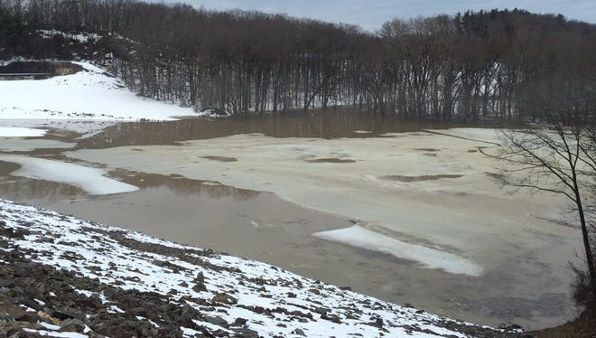 Water fills in at Indian Rock Dam Thursday morning. Some areas might see flooding because of the rain and melting snow, though no flood watches are in effect.