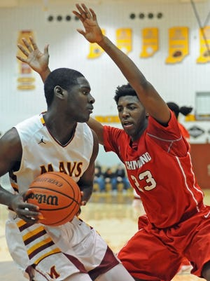 Maverick Darnell Butler drives into the paint against Richmond's Adrion Gibson Saturday night during NCC tournament play.
