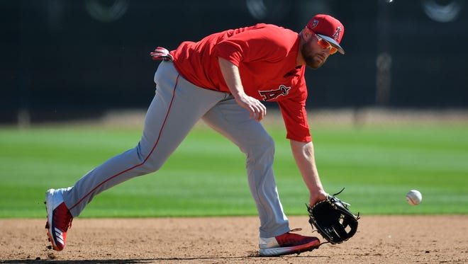 Los Angeles Angels infielder Zack Cozart fields a ground ball during a workout at Tempe Diablo Stadium.
