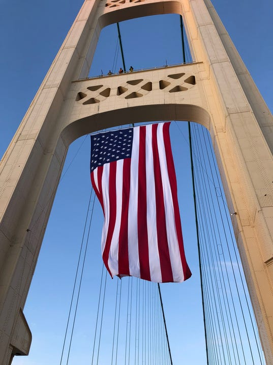 mackinac bridge flies giant american flag