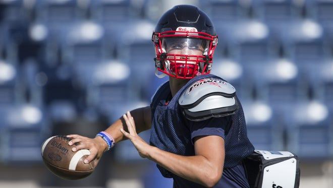 Scottsdale Christian Academy's freshman quarterback Jack Miller passes during a practice at Scottsdale Christian Academy on August 8, 2016 in Scottsdale, Ariz.