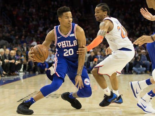 Philadelphia 76ers guard Markelle Fultz (20) dribbles past New York Knicks guard Trey Burke (23) during the first quarter at Wells Fargo Center.