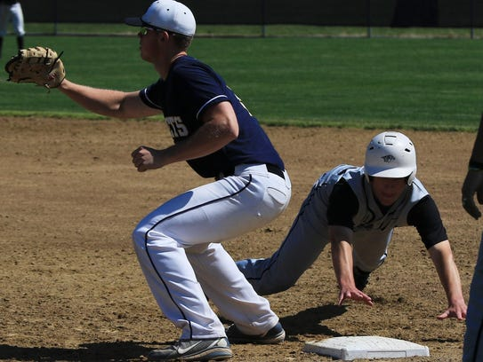 Diving back to first base during the fifth inning of