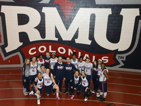 Sal Buscaglia, center left, and the Robert Morris women's