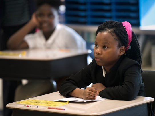 Tadaysia Boyd, 8, listens intently as Madison County