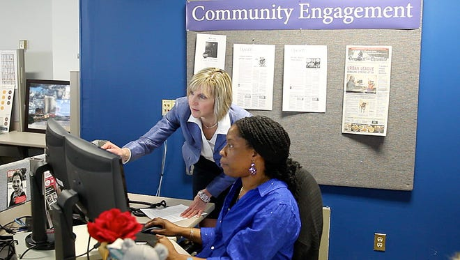 Senior Engagement Editor Julie Philipp, left, with Community Engagement Editor Sheila Rayam, collaborating in our newsroom.