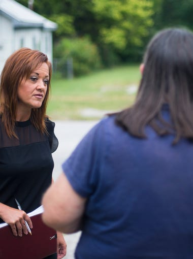 The first ever Springfield-based community mental health liaison Melissa Daugherty visits the home of a woman on the city's north side on Sept. 1. The woman first met Daugherty soon after making suicidal statements to police.