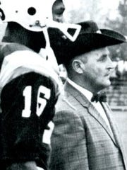 Mansfield native Bill Doolittle, in his trademark cowboy hat and bow tie, watches from the sidelines during one of his games as coach at Western Michigan. He put the football program — which plays Ohio State on Saturday — on the map.