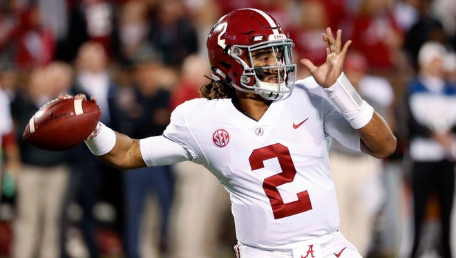 Alabama quarterback Jalen Hurts (2) drops back to pass against Mississippi State during the first half of an NCAA college football game in Starkville, Miss., Saturday, Nov. 11, 2017.