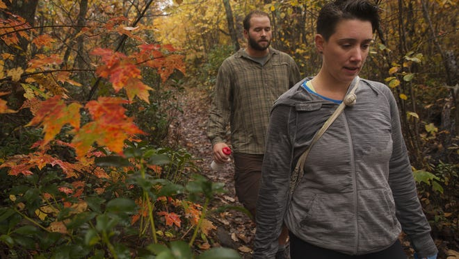 "Chloe Hawkins, right, and Nathan Foley, both from Charlottesville, hike along Riprap trail in the Shenandoah National Park on Sunday, Oct. 12, 2014. ""There were areas that were totally yellow, and red, the colors were totally fantastic,"" said Hawkins, describing the fall foliage."